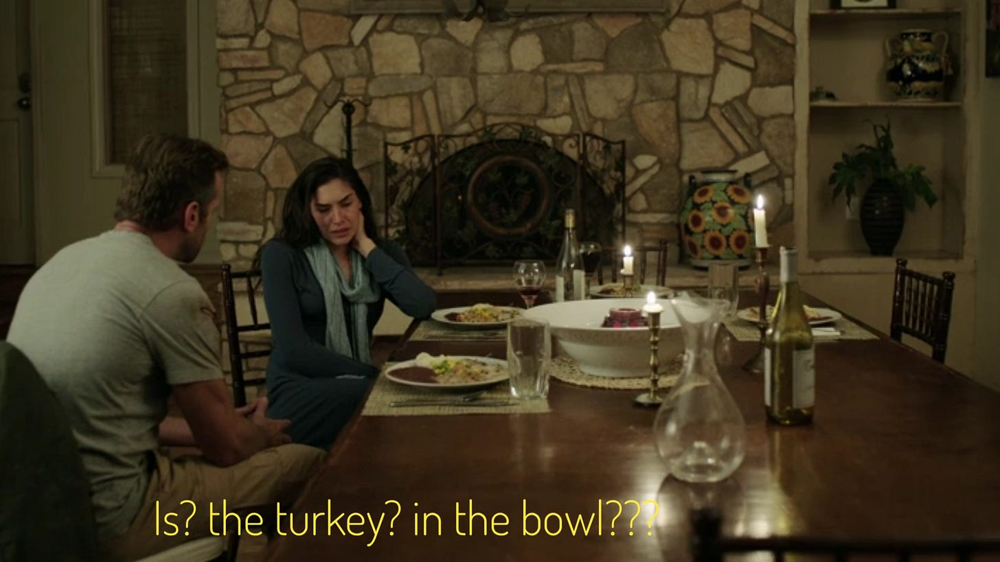 """Trish being consoled by DJ at a long table in front of a fireplace, there's a huge bowl with some kind of roast in it, captioned """"Is? the turkey? in the bowl???"""""""