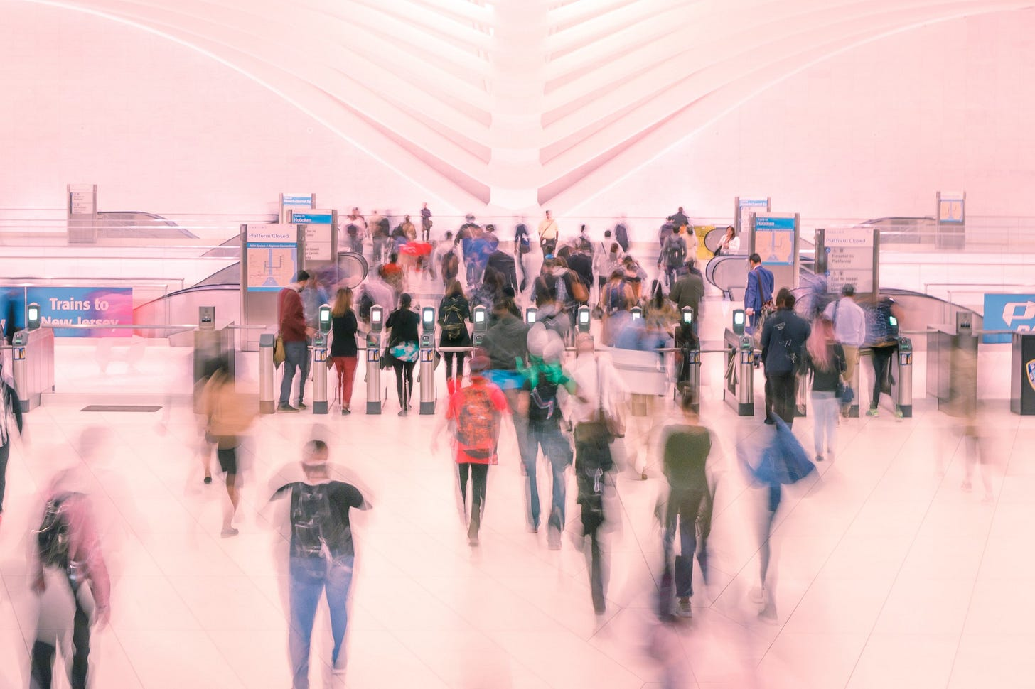 Blurred image of people in a mall for article by Larry G. Maguire