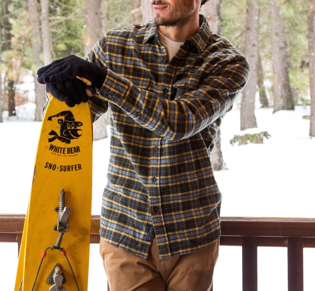 the grayers flannel shirt made from a custom cut cloth. and a guy wearing it with a sno surfer