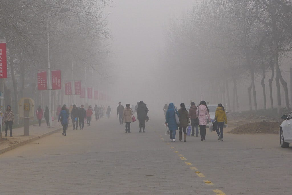 University students come and go in the dense air pollution