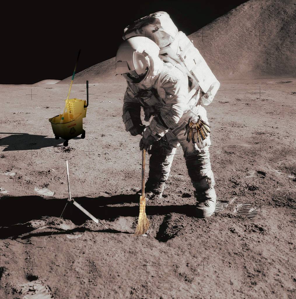 .Astronaut on moon with broom and mop