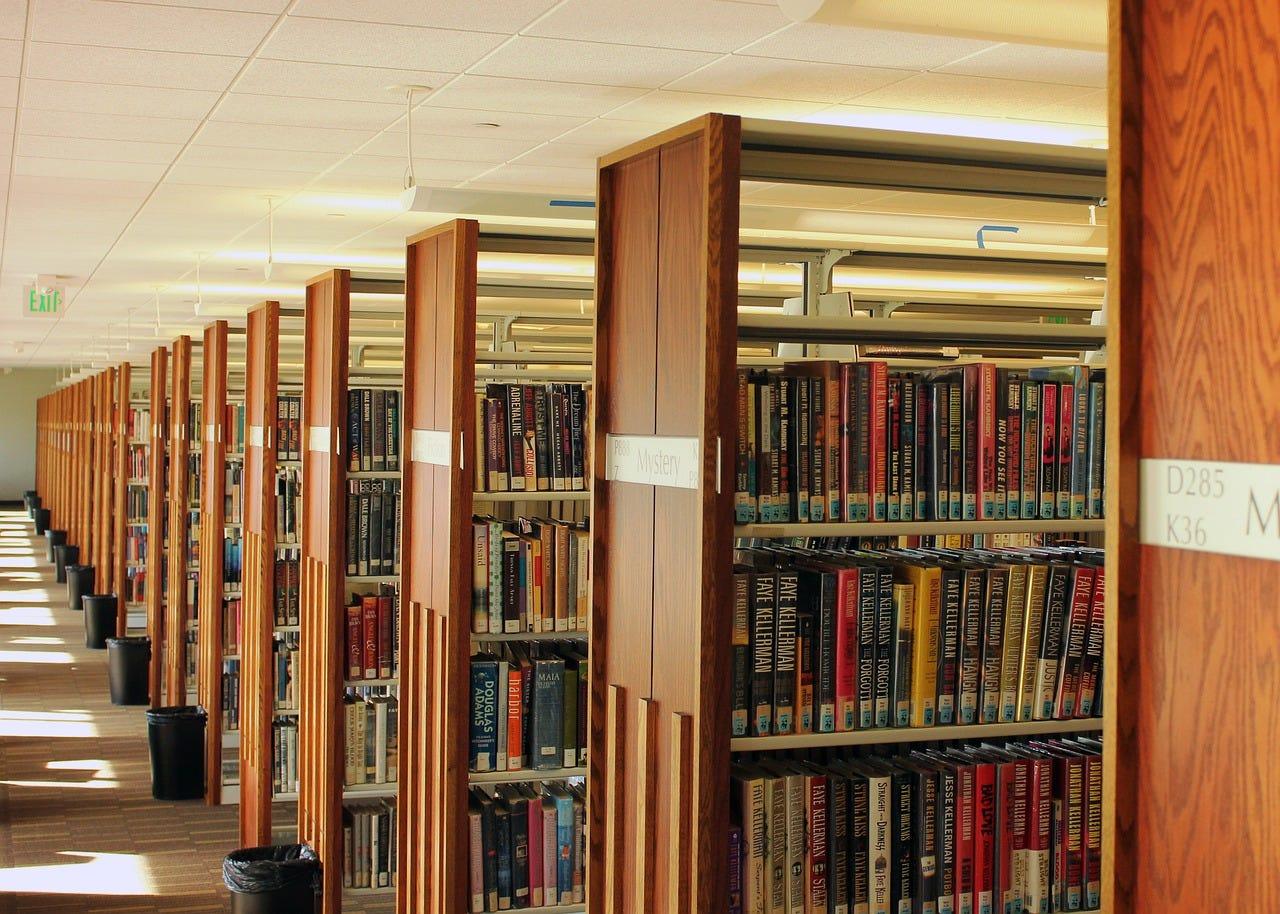Books Library Stacks - Free photo on Pixabay