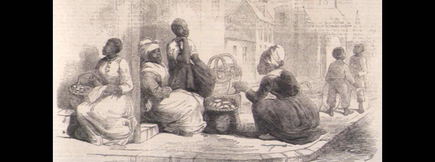 Women selling sweet potatoes on street