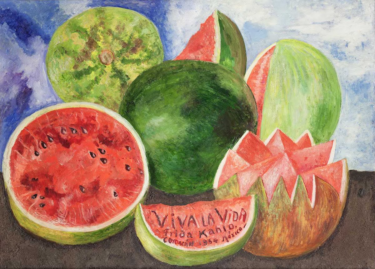 """A group of richly colored watermelons contrasts on a dark surface and a bluish background. The watermelons are bursting with pink and green vibrancy and show different curves and angles. Some of the fruits appear whole while others are sliced in different forms and shapes.The words """"Viva la Vida"""" are inscribed on the central melon wedge at the bottom of the canvas which translates to """"Long Live Life."""""""