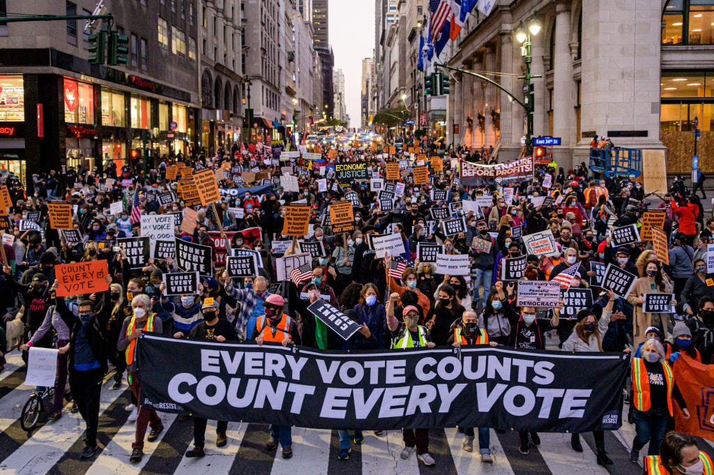 """2020/11/04: Participants holding a banner reading: """"EVERY VOTE COUNTS/COUNT EVERY VOTE"""" at the protest."""