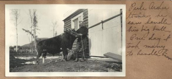 """In front of the Archer barn, the Parks barn can be seen in the distance, along with Bodenburg Butte. Glen Archer's great grandmother Lillian Post wrote near it, """"Perle Archer thinks he can handle his big bull. One day it took many to handle him."""""""