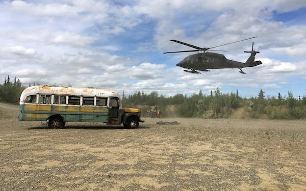 An Alaskan army helicopter removes the Into The Wild bus from the wilderness