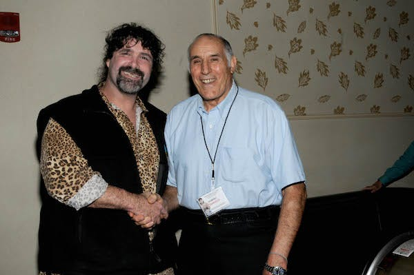 Mick Foley shakes hands with Dominic DeNucci