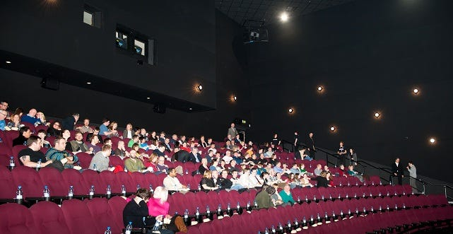 The audience prepares for Mission Impossible: Ghost Protocol