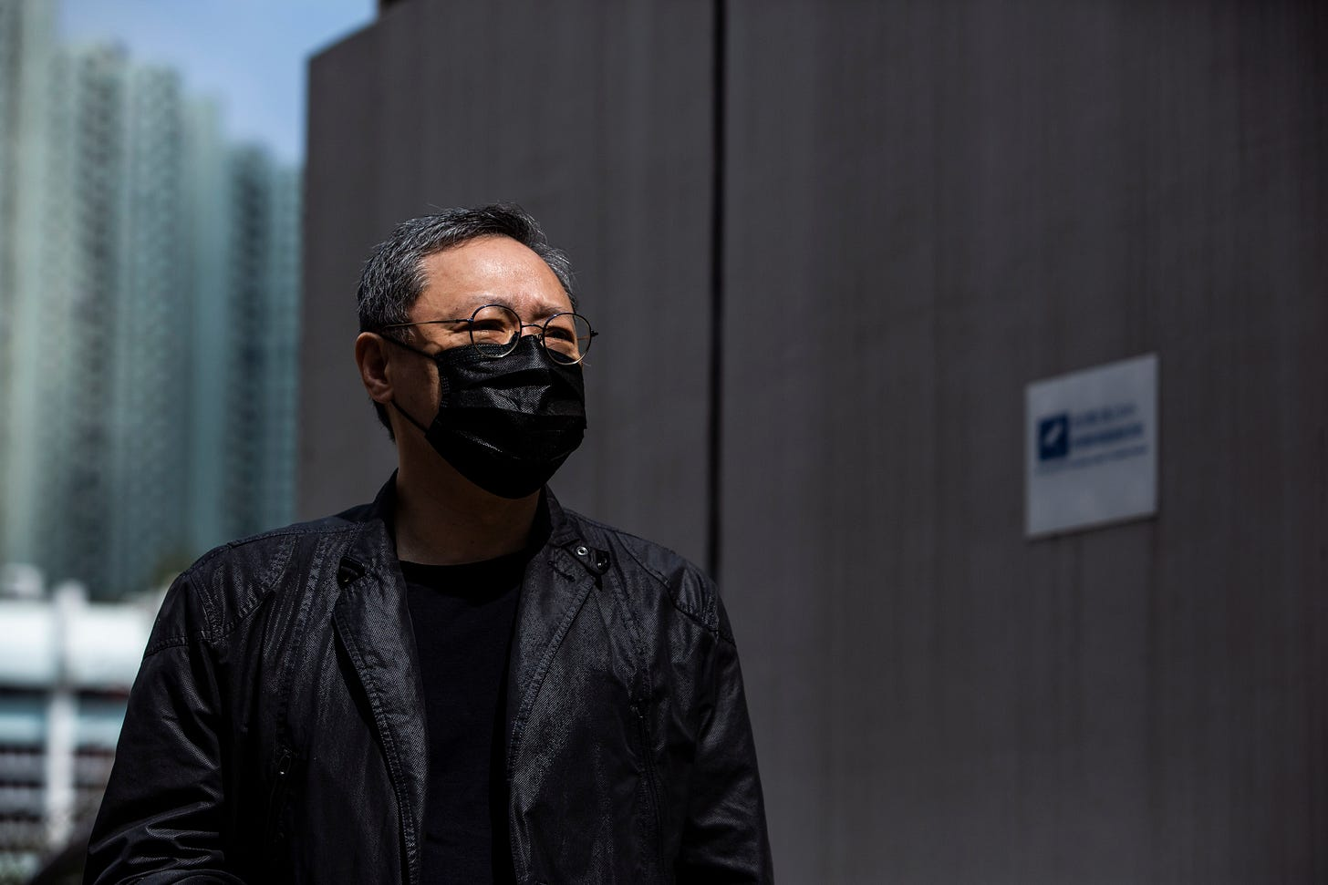 """Hong Kong law professor and pro-democracy activist Benny Tai arrives at Ma On Shan police station in Hong Kong on February 28, 2021, where he and 46 other dissidents were each charged with one count of """"conspiracy to commit subversion"""" under the city's new national security law. (Photo by ISAAC LAWRENCE / AFP) (Photo by ISAAC LAWRENCE/AFP via Getty Images)"""