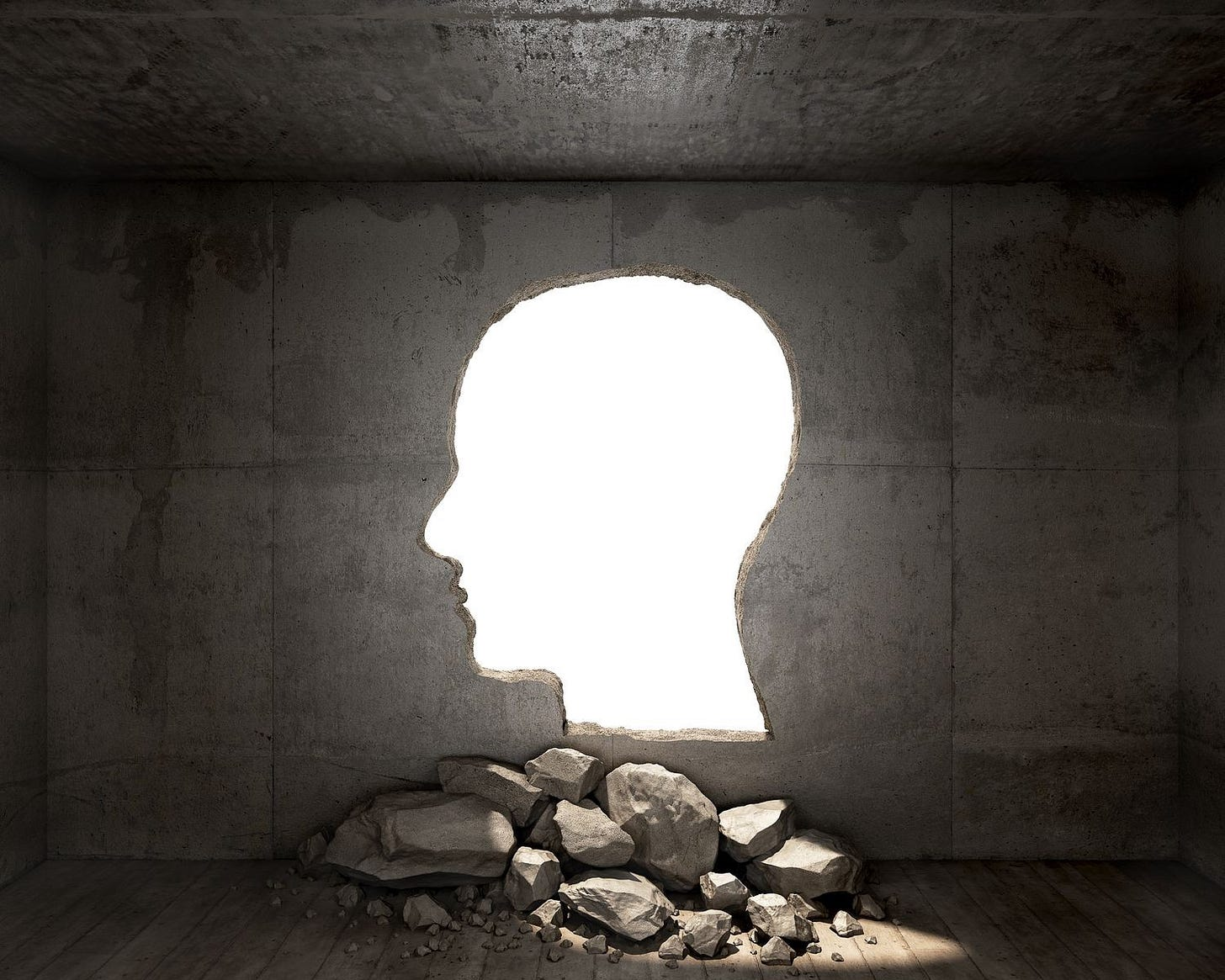 Head shape cut out of a wall, letting light in.