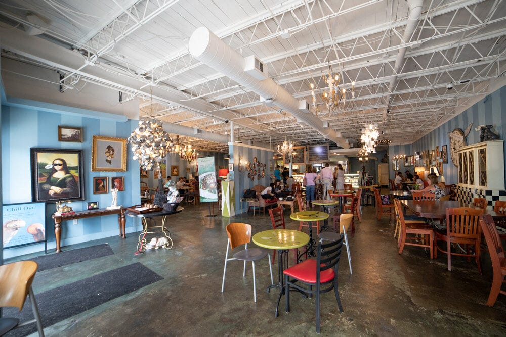 A wide angle view of the interior of Amélie's Bakery in Atlanta.