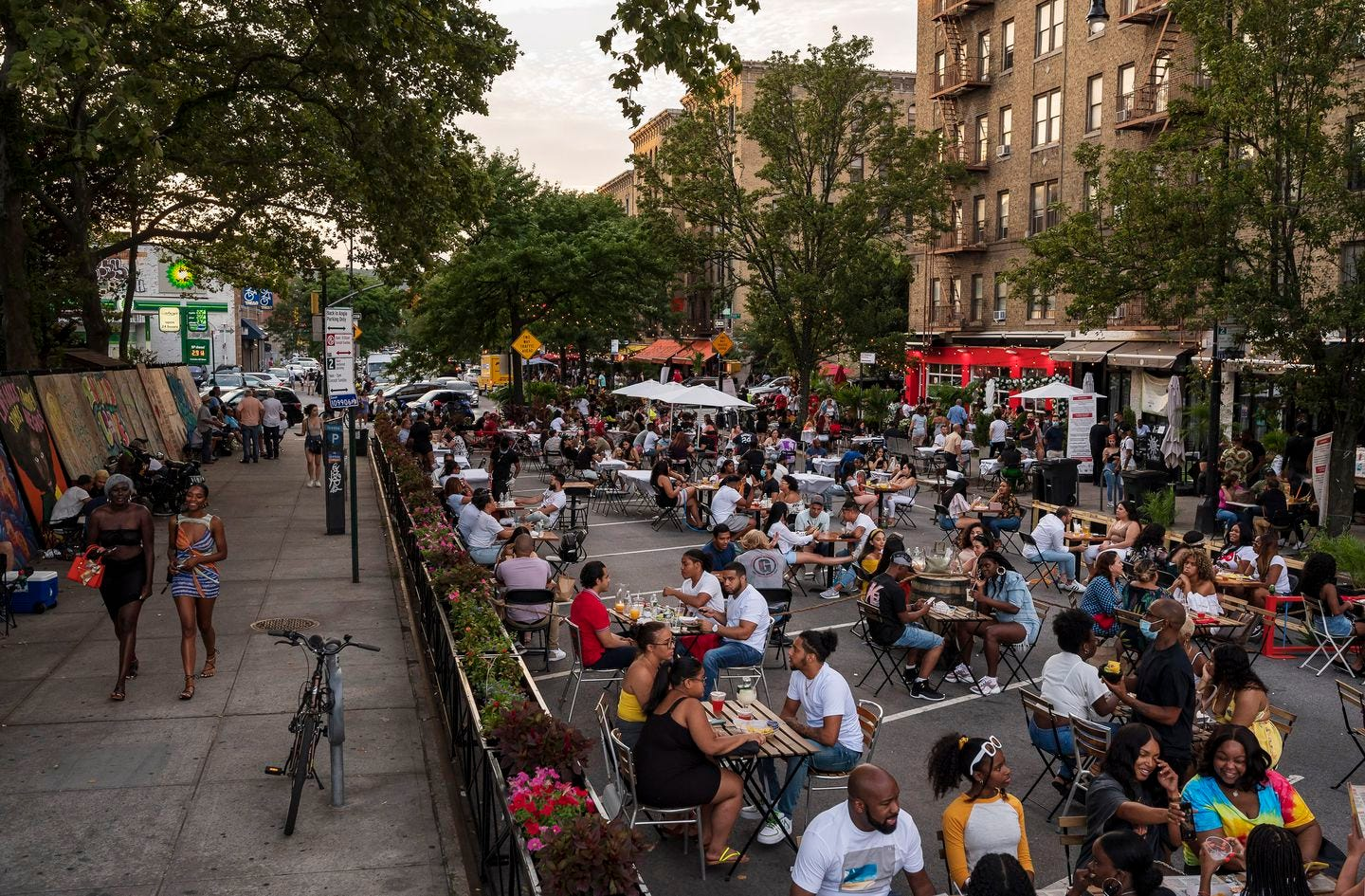 Restaurants have taken over Dyckman Street in northern Manhattan, which has been temporarily closed to cars during the coronavirus pandemic.