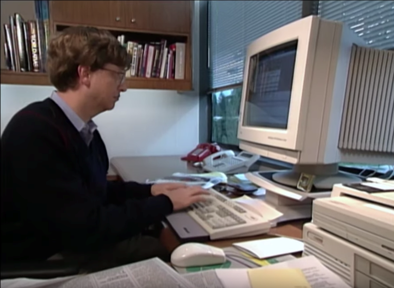 Photo of Bill Gates working at a computer, c. 1994