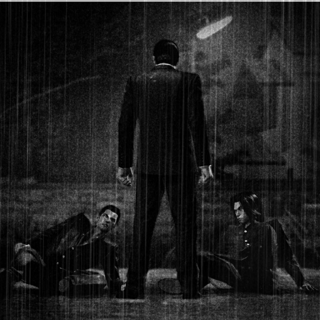 A black and white image of Kiryu and his sworn brother as teenagers. It is raining. The image is dark, gloomy. The boys' father is looming over them, his back to the camera.
