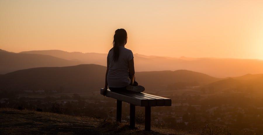 Lady watching sunset and thinking