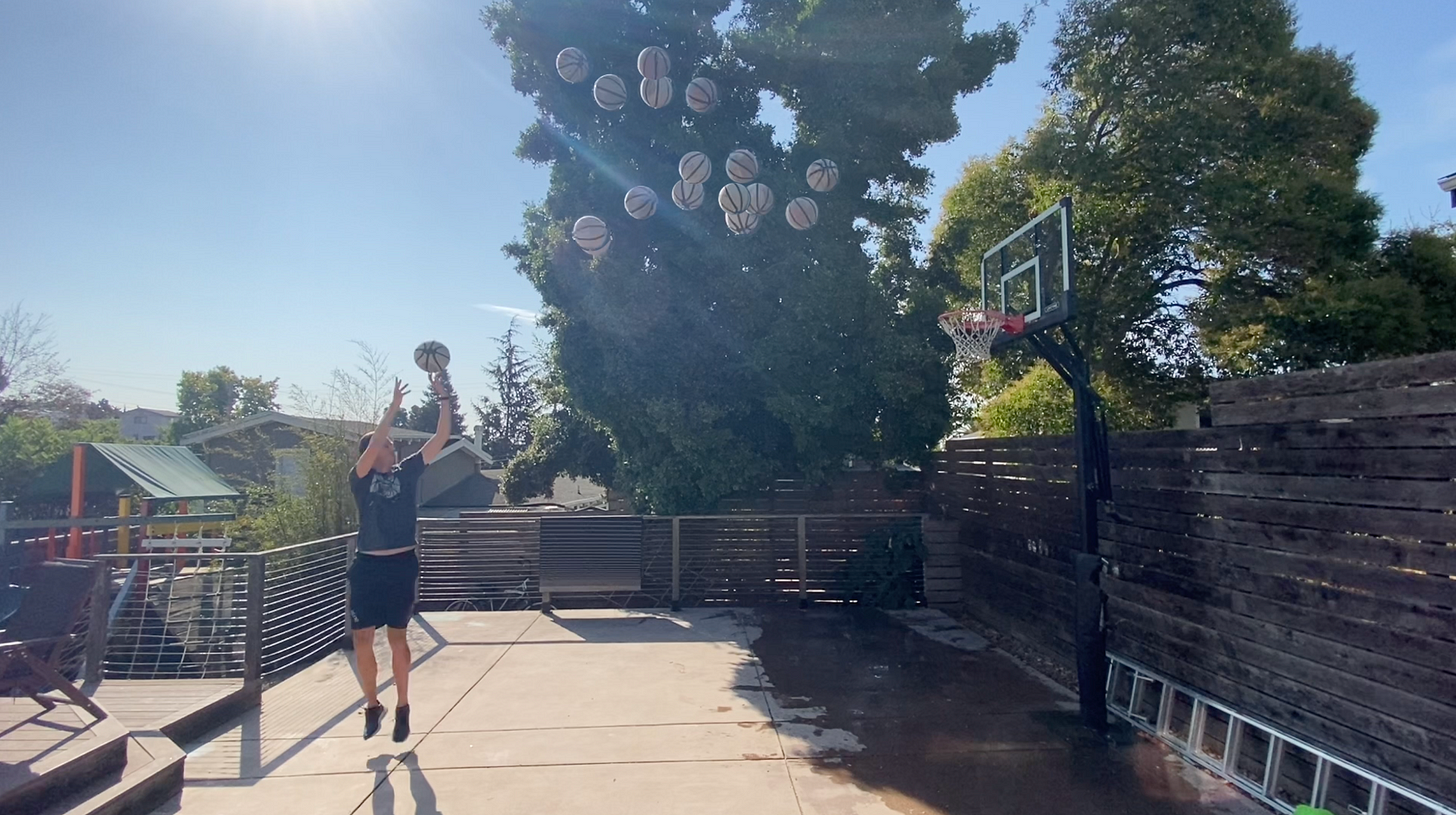 Some guy shooting lots and lots of basketballs at a hoop.