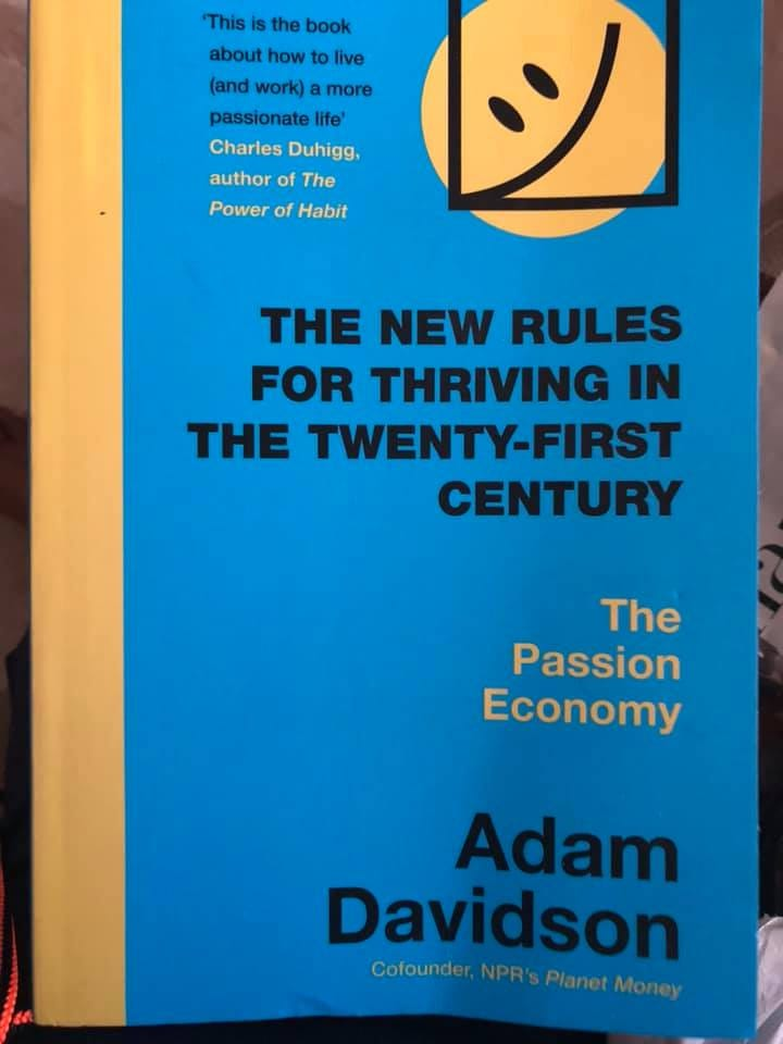 Image may contain: text that says 'This is the book about how to live (and work) more passionate life Charles Duhigg, authorof author The Power of Habit THE NEW RULES FOR THRIVING IN THE TWENTY-FIRST CENTURY The Passion Economy Adam Davidson Cofounder, NPR's Planet Money'