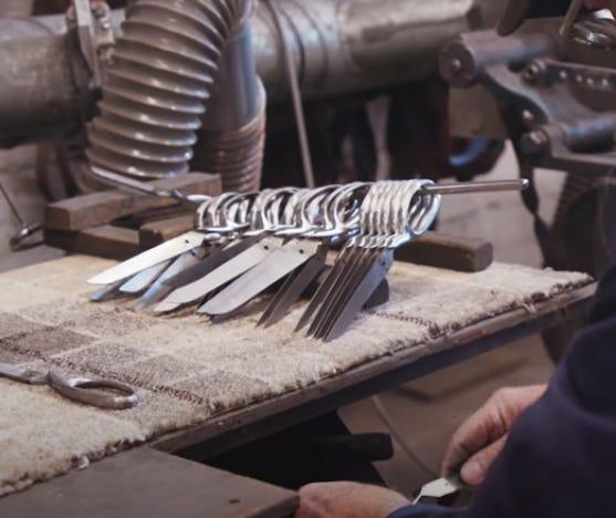 half of a scissor being made