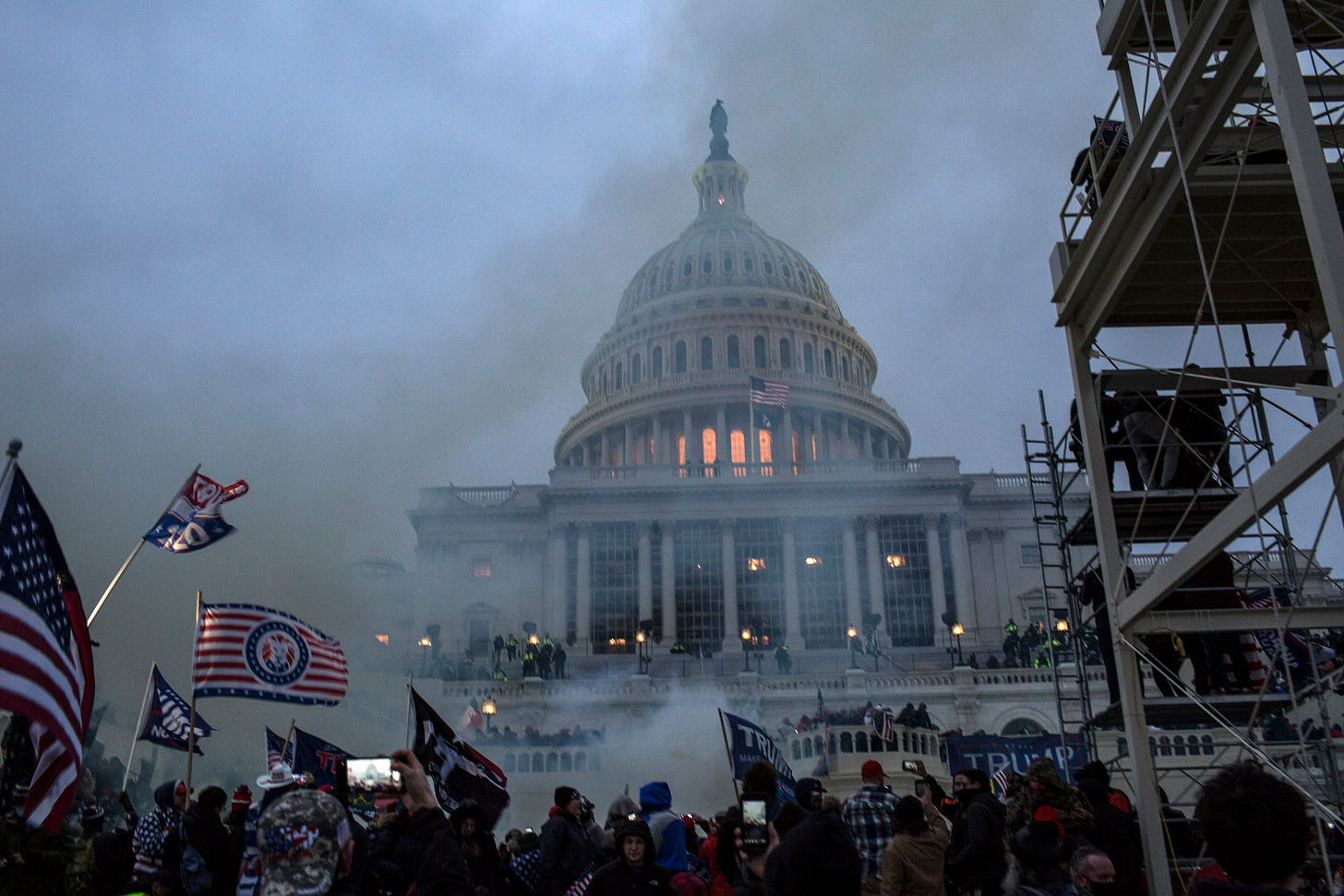 : Security forces respond with tear gas after the US President Donald Trump's supporters breached the US Capitol security. Pro-Trump rioters stormed the US Capitol as lawmakers were set to sign off Wednesday on President-elect Joe Biden's electoral victory in what was supposed to be a routine process headed to Inauguration Day. (Photo by Probal Rashid/LightRocket via Getty Images)