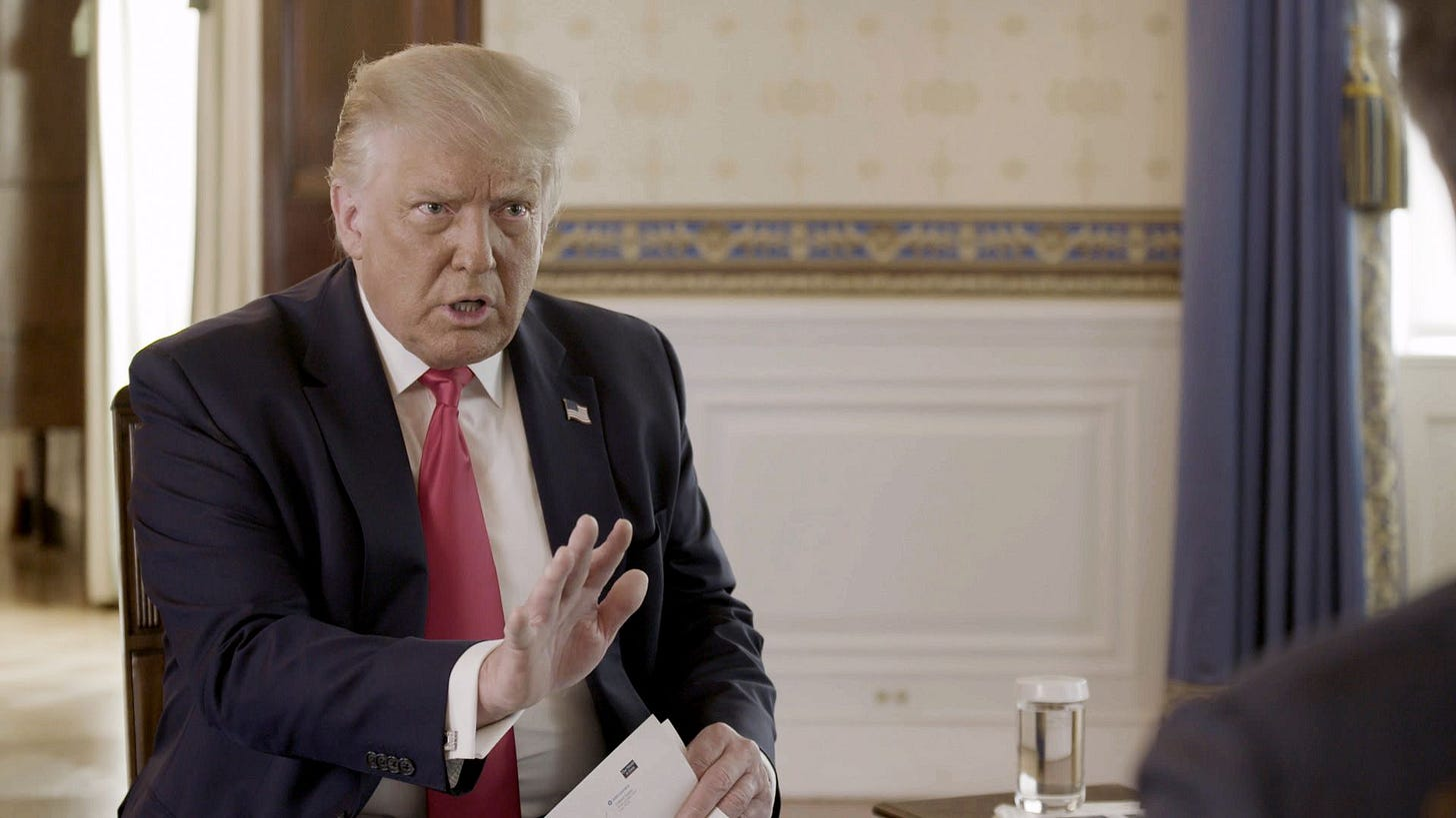 President Trump gestures as he talks during an Axios on HBO interview