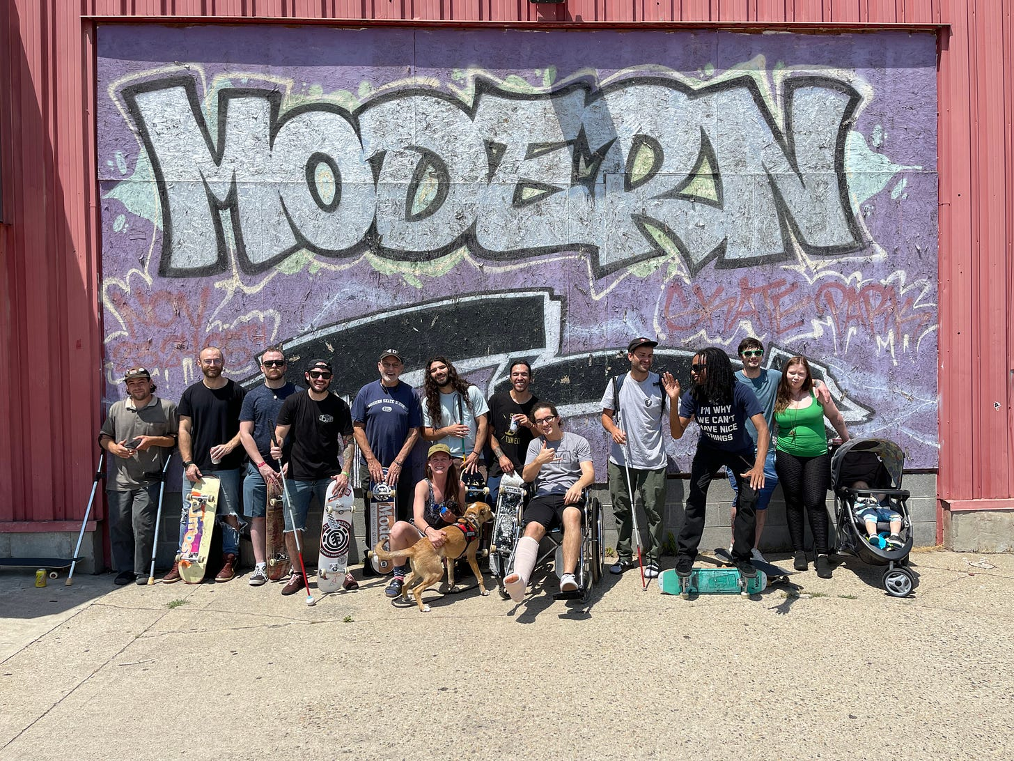 The largest gathering of of Blind and Adaptive Skaters in the History of the World! pictures in front of rad graffiti saying Modern skate