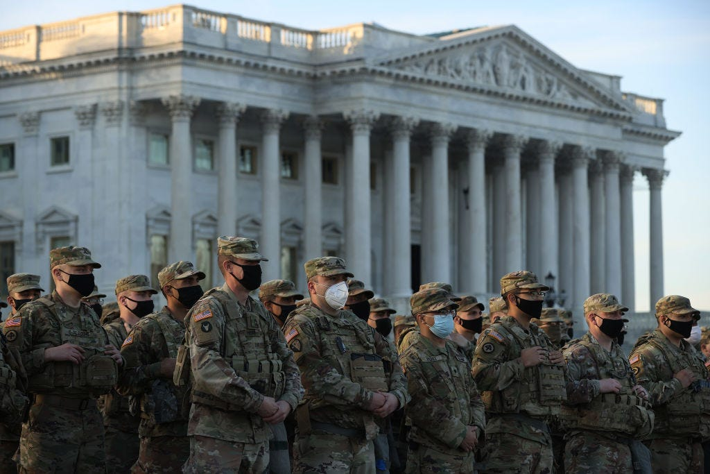 National Guard troops on the East Front of the U.S. Capitol on Thursday. (Chip Somodevilla / Getty Images)
