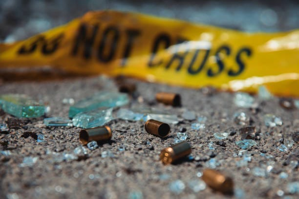 Bullet casings Bullet casings and broken glass. Crime scene. crime stock pictures, royalty-free photos & images
