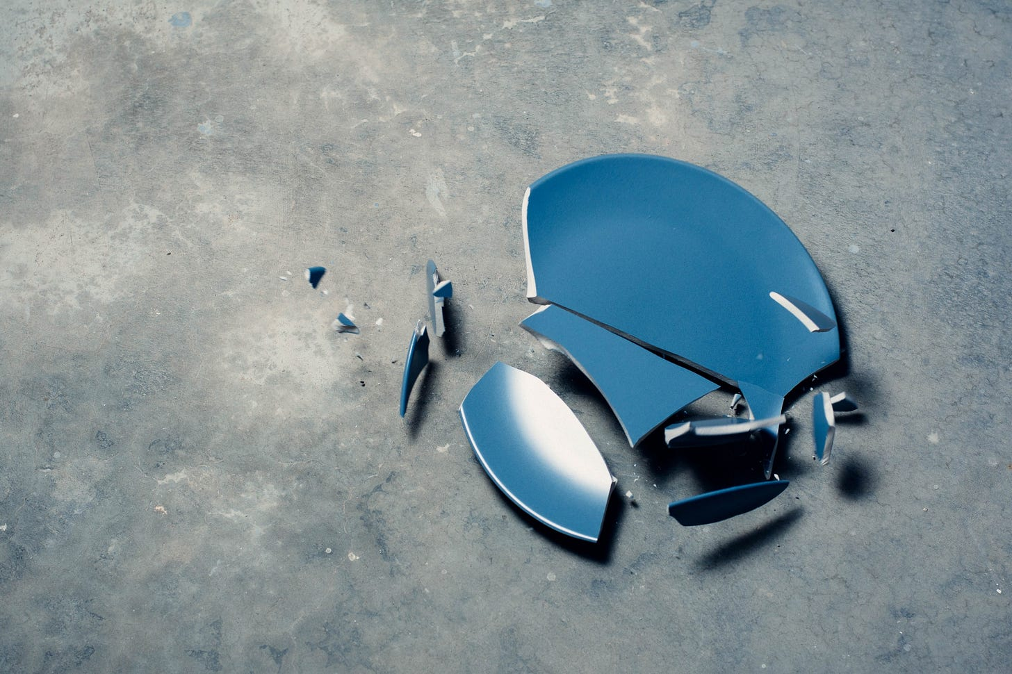 """Image of a blue plate smashed on the floor for article titled """"What If You Can't Fix Yourself"""" on The Reflectionist"""