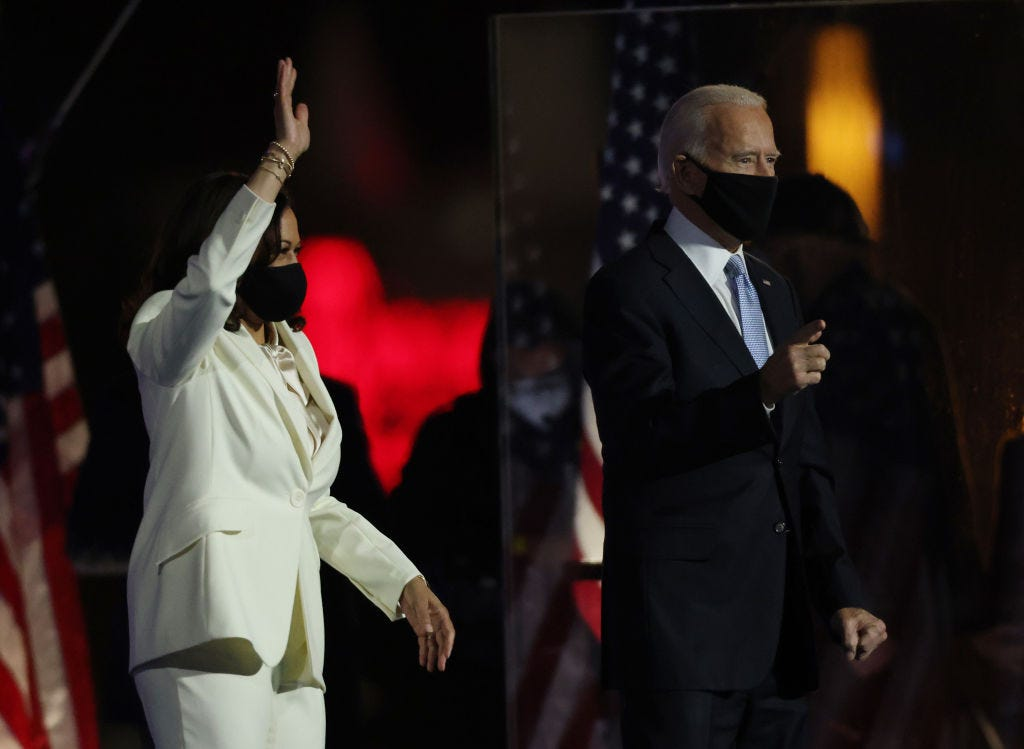 President-elect Joe Biden and Vice President-elect Kamala Harris take the stage at the Chase Center to address the nation Saturday in Wilmington, Delaware. (Win McNamee / Getty Images)