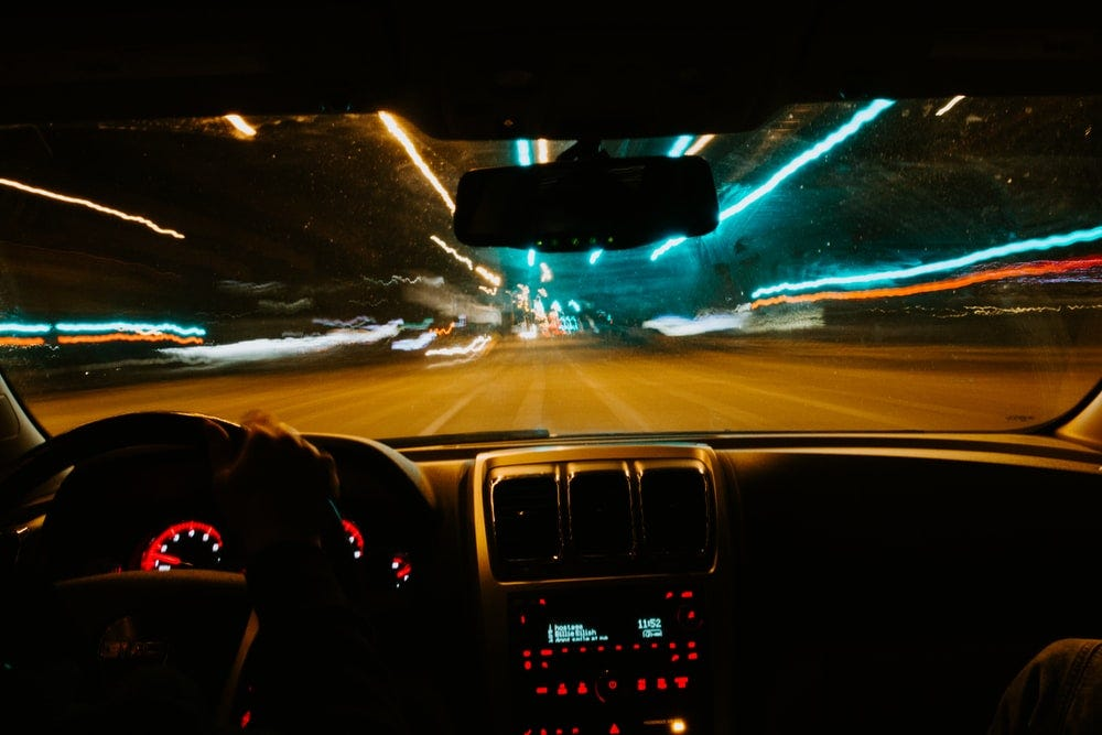 person driving car during night time