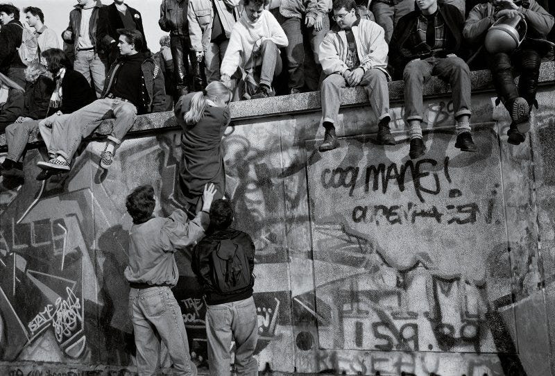 Crowds atop the Berlin Wall on the morning after it fell, Nov. 10, 1989.