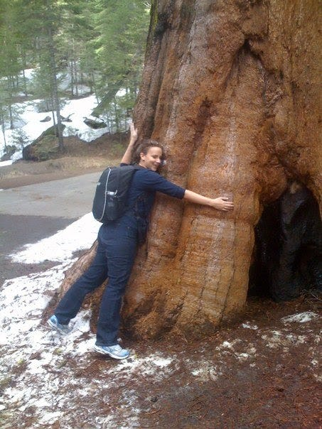 A photo of Margarita hugging a giant tree