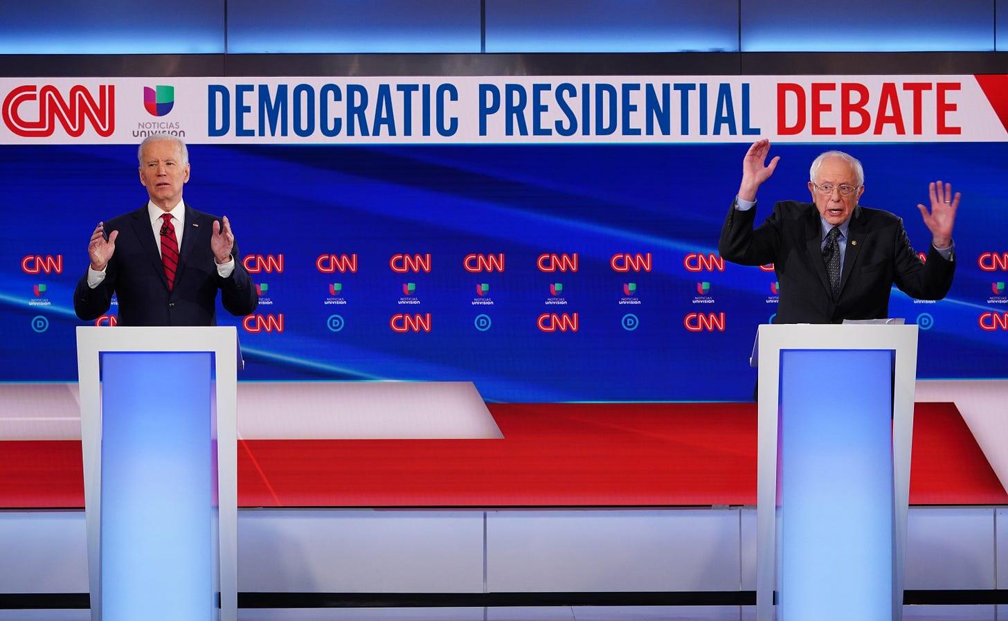 Biden stands next to Sanders at Democratic Presidential Debate