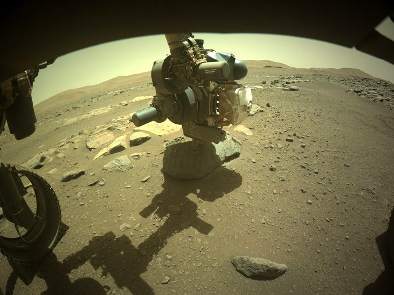 The rover drilling the hole