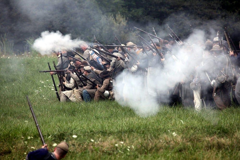 men holding rifles