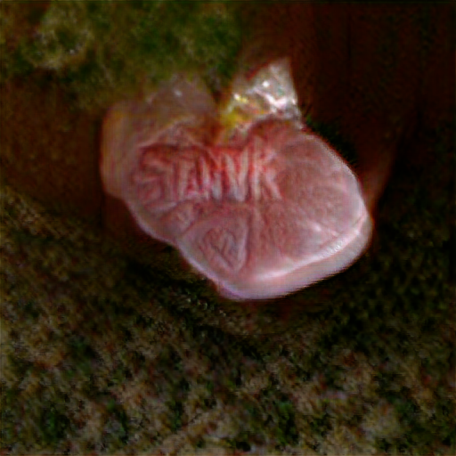 It looks like nothing more than a tightly cellophane wrapped human heart with the word Stannk standing out on it in veins.