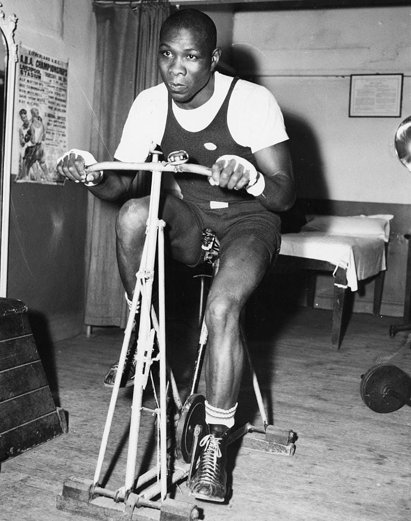 American boxer Sonny Ray working out on an exercise bike during training