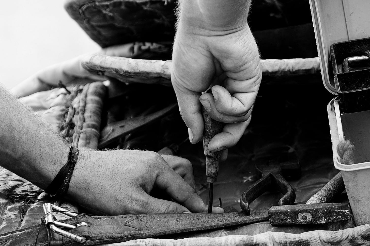 hands working on a leather belt for article titled legitimacy of a business of one by Larry G. Maguire