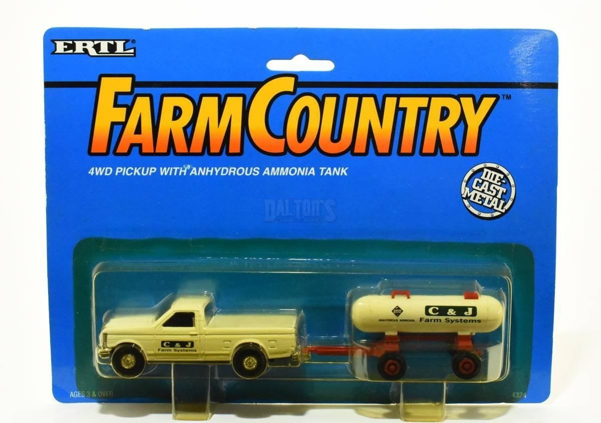 """A """"Farm Country"""" branded toy of a four wheel drive pick-up truck hauling a tank of anhydrous ammonia gas"""