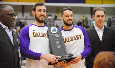 Sam Rowley with Peter Hooley as 2015 America East Champions - Courtesy University at Albany Media Relations