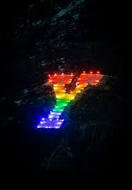 LGBTQ students at BYU light up the 'Y' in rainbow colors