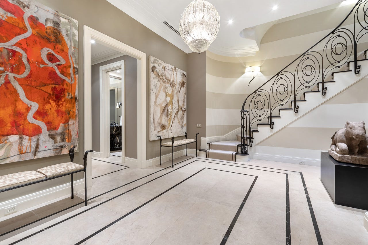 The large entryway has limestone flooring and Noir St. Laurent marble inlay. 'The configuration of the house was a lot of small rooms on the third floor. There were like five bedrooms,' said Mr. Chez. 'I like bigger, open as much as possible.' The renovation took between three and four years and cost roughly $6 million dollars.