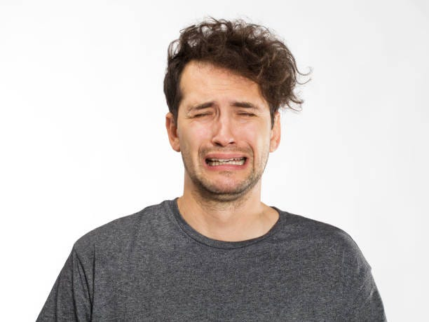 Frustrated and worried young man portrait in grey t-shirt Portrait of an angry young man crying stock pictures, royalty-free photos & images