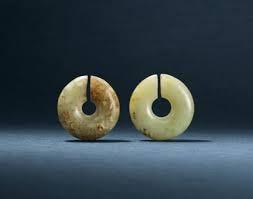 TWO JADE EAR ORNAMENTS, JUE | XINGLONGWA CULTURE, CIRCA 6200-5400 BC | jade/jadeite,  China | Christie's