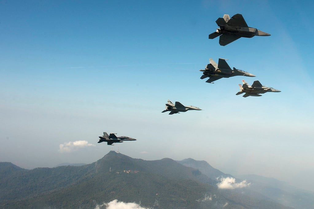 F-15 Eagle's from the 104th Fighter Wing, Massachusetts Air National Guard, train with U.S. Air Force F-22 Raptors and members of the Royal Malaysian Air Force in Malaysia