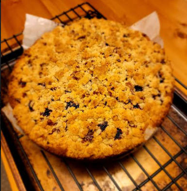 fully-baked round cake on a cooling rack