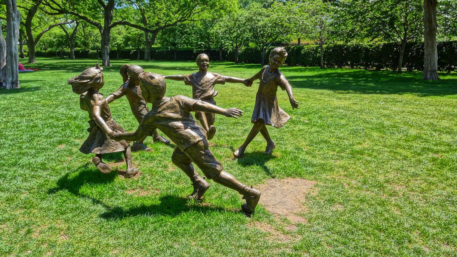 Bronze Sculptures of children at play at the Dallas Arboretum gardens