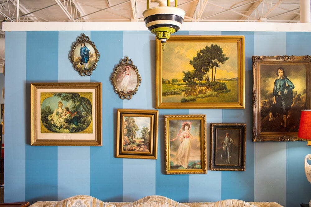 Painting reproductions at Amélie's Bakery. Thomas Gainsborough's  The Blue Boy   makes about a dozen appearances throughout the cafe.