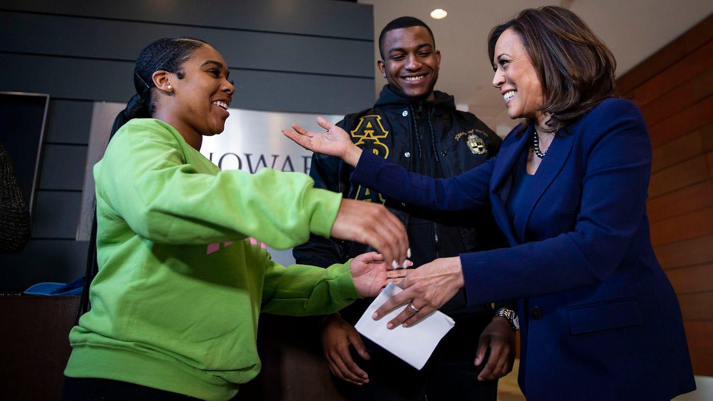 U.S. Sen. Kamala Harris hugs Mara Peoples, Executive Vice President of the Howard University Student Association, beside Amos Jackson III, Executive President